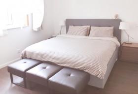 光与影的两居 123平实用都市简宅 床头软包装修