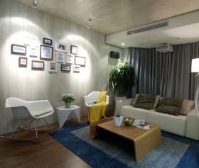 现代风格客厅沙发照片墙装修效果图